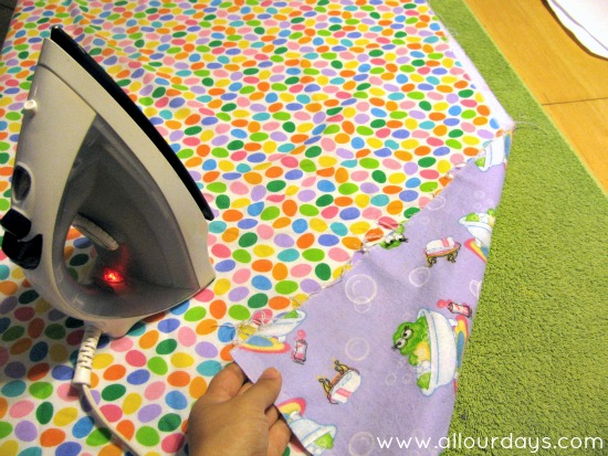 iron both fabrics and place wrong sides together...Full-Coverage Child's Apron Pattern & Tutorial ©AllOurDays.com