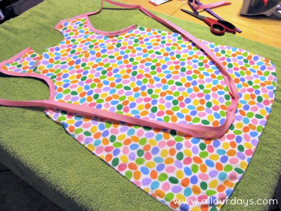 sew bias tape to shoulders...Full-Coverage Child's Apron Pattern & Tutorial ©AllOurDays.com