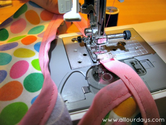 continue sewing bias tape between shoulder and apron body to create armhole...Full-Coverage Child's Apron Pattern & Tutorial ©AllOurDays.com