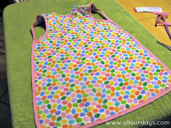 bias tape sewn to armholes and apron body...Full-Coverage Child's Apron Pattern & Tutorial ©AllOurDays.com